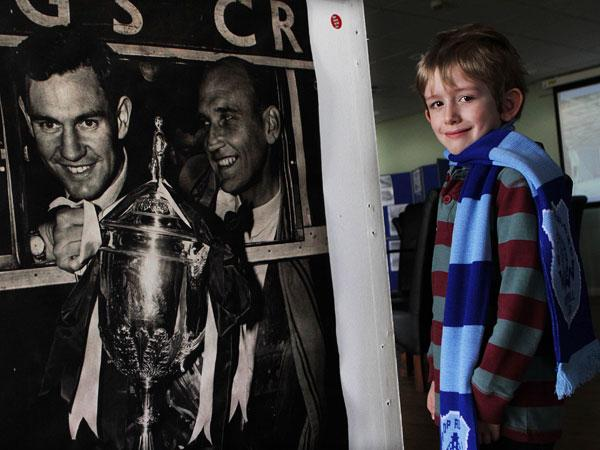LOOKING BACK: Six-year-old Oliver Cowey looks at the memorabilia on display at Bishop Auckland Football Club