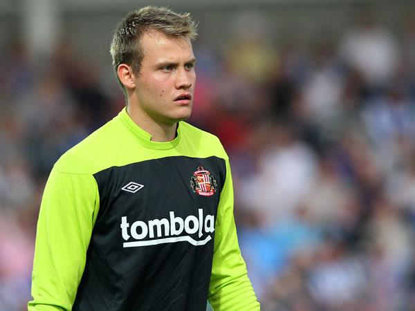 COMPETITION FOR PLACES: Simon Mignolet