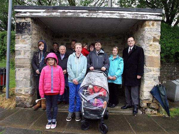 The Advertiser Series: MP Phil Wilson, right, with Brafferton villagers at the now disused bus stop last year
