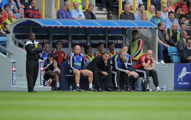 IN THE LIONS' DEN: Mowbray and the Boro bench look glum during Saturday's defeat at Millwall
