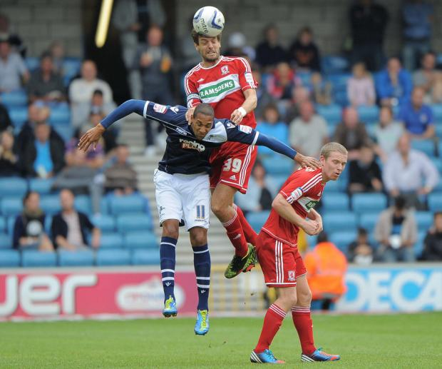HEAD BOY: Jonathan Woodgate beats Millwall's Shaun Batt to the ball. Picture: Matt Bright