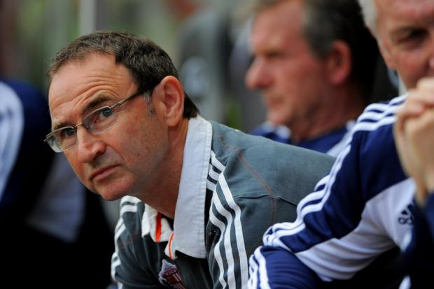 CONCENTRATION: Martin O'Neill watches his team earn a point at Swansea on Saturday