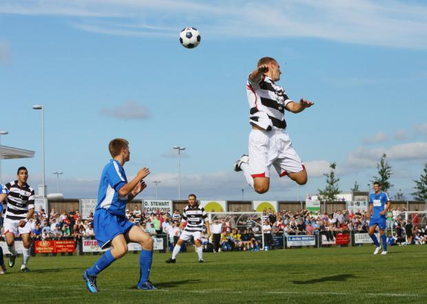 HIGH FLYER: David Dowson rises to win the ball against Consett