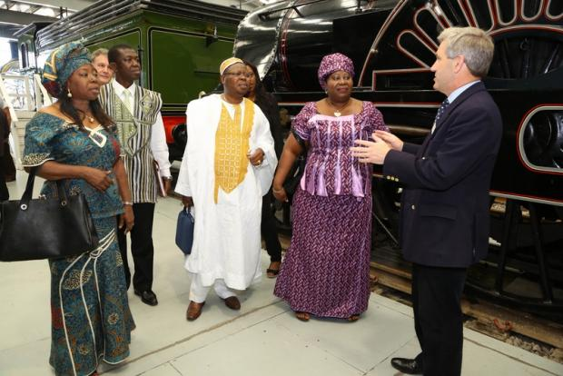 RAIL VISIT: Tamba Ngegba, centre, and his party with museum director Steve Davies