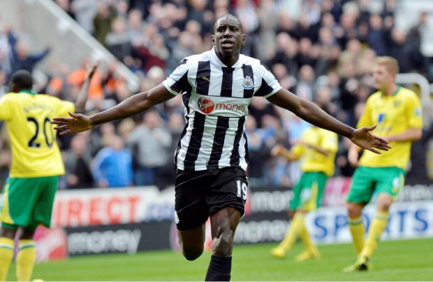 Newcastle striker Demba Ba celebrates his winner against Norwich
