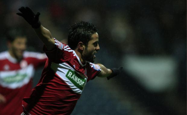 FLYING HIGH: Zemmama celebrates making it 2-0 at Deepdale