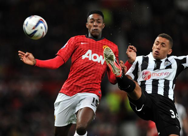 SHOULDER TO SHOULDER: Manchester United's Danny Welbeck goes for the ball alongside Newcastle's James Tavernier last night