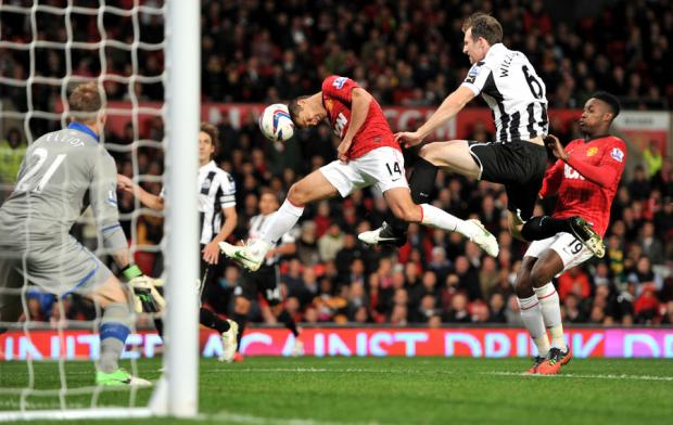 HEADS UP: Javier Hernandez heads towards goal past Newcastle United's Mike Williamson during the Capital One Cup third round match at Old Trafford
