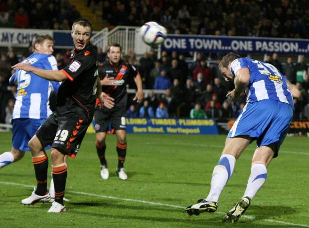 TOWERING HOWARD: Hartlepool striker Steve Howard scores his side's equaliser, only to see Paul Gallagher score a late winner for Sheffield United
