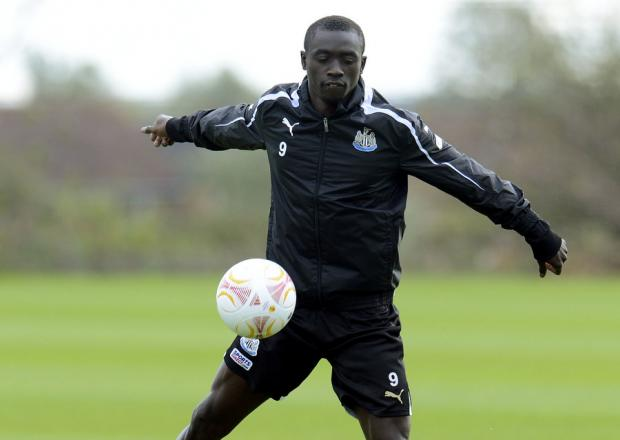 STRONG SIDE: Papiss Cisse, pictured during training at Longbenton yesterday, is likely to start this evening with manager Alan Pardew expected to select a strong line-up