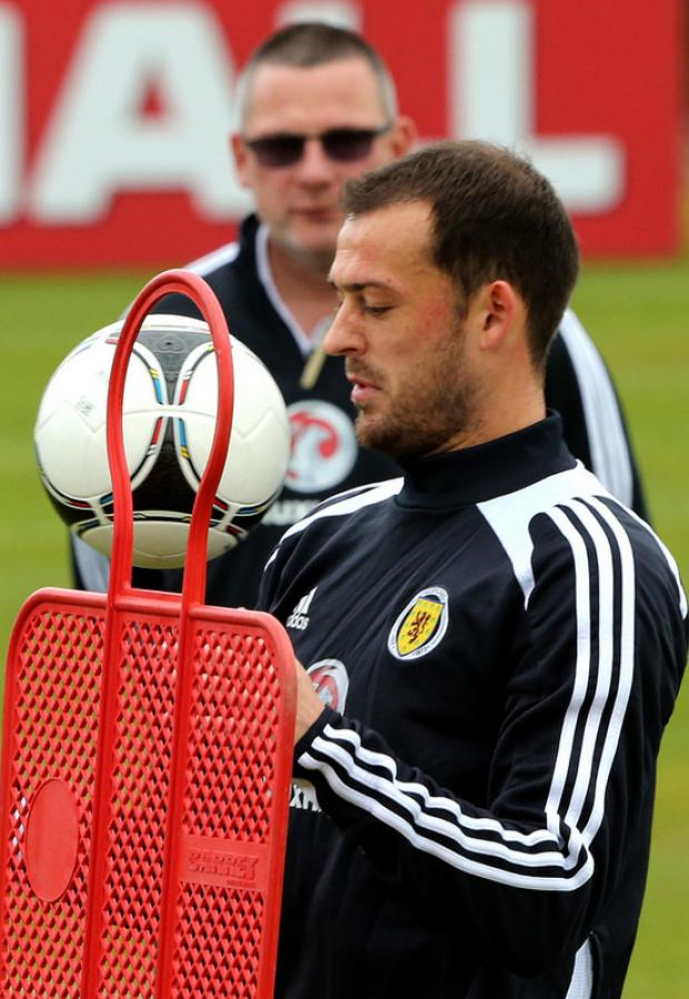 HERE'S LOOKING AT YOU: Boss Levein looks on as Fletcher takes part in training yesterday ahead of Friday's world cup qualifier with Wales