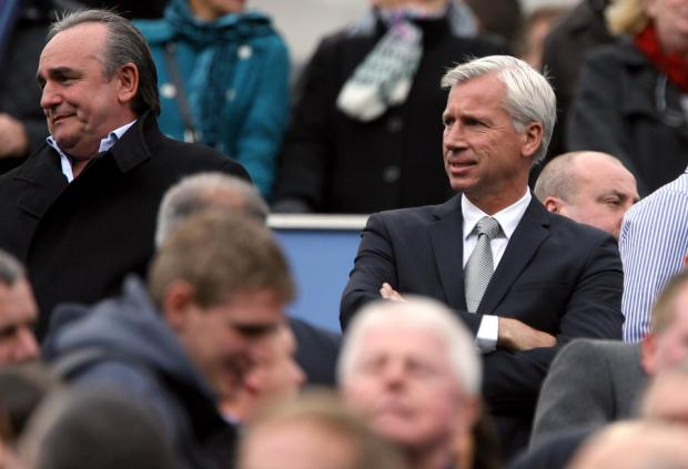 RULE THE WORLD: Derek Llambias, left, with Newcastle manager Alan Pardew as the Magpies plan to increase their profitability on the world market
