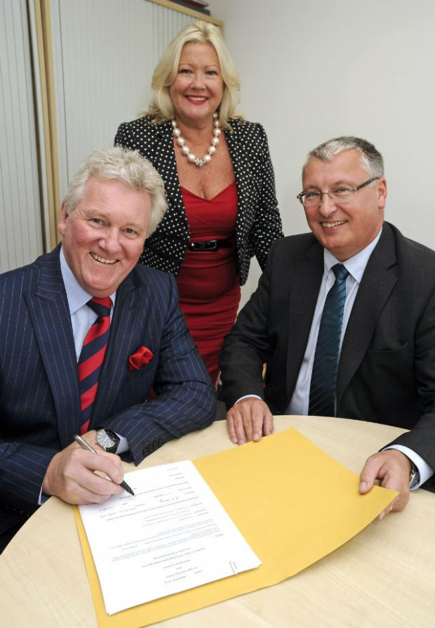 SALVAGE DEAL: FW Solutions owners Rodney and Sandra Hardy sign new contract with Malcolm Armstrong of Tyneside firm Access Training.