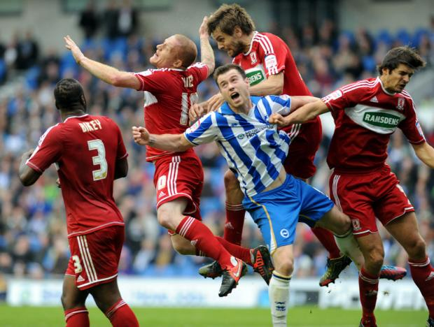 SURROUNDED: Brighton's Ashley Barnes is outnumbered by Boro players at the Amex Stadium