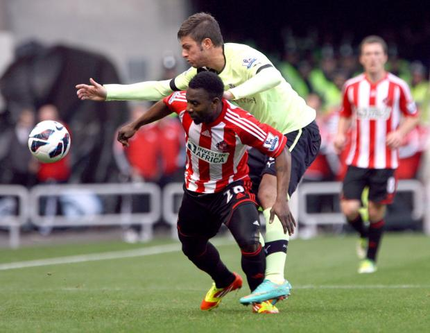 CLOSE ATTENTION: Sunderland's Stephane Sessegnon and Newcastle's David Santon yesterday