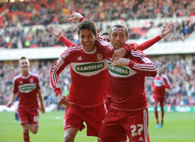 DOUBLE ACT: McDonald celebrates with Ledesma after his second goal secured a 2-1 win