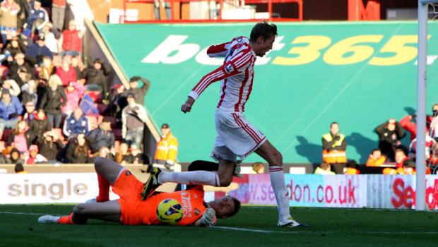 KEY MAN: Mignolet saves at the feet of Crouch – the goalkeeper was again Sunderland's brightest performer
