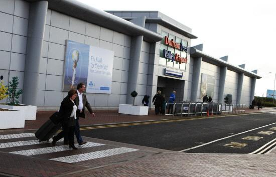 Passengers arrive at Durham Tees Valley Airport.