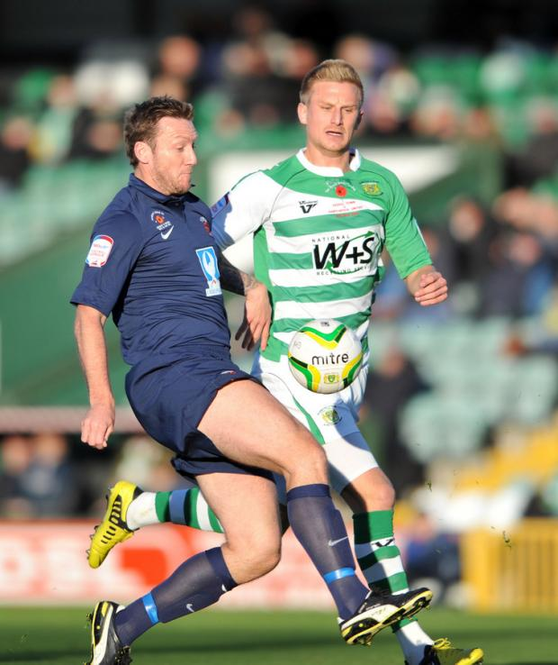 The Advertiser Series: CLOSE ATTENTION: Steve Howard, left, is chased down by a Yeovil player