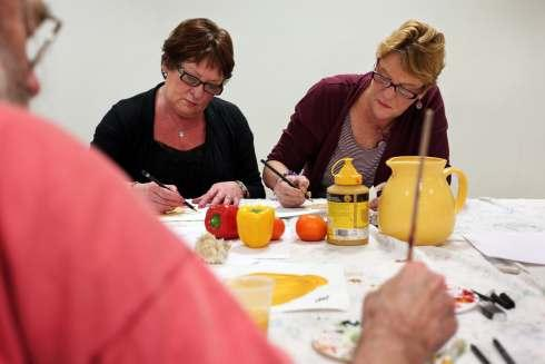 From left, Colour Your Life participants Brenda Hutchinson and Christine McCormick at work during one of the art classes at the Pioneering Care Centre in Newton Aycliffe.