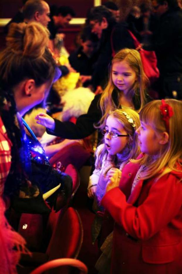 Children examine a pantomime props during a visit to Darlington Civic Theatre by the Durham Support Group for Families with Visually Impaired Children.