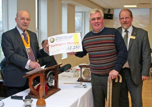 CHARITY THANKS: From left, Rotary senior vice president Ken Young, Mencap's Tom Stebbings and Rotarian Steve Rose