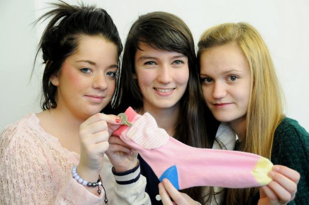 BRIGHT IDEA: From left, Lauren Walker, Abigail Fawcett and Victoria Trainor with the Sokit