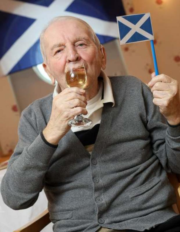 88-year-old Tommy Hughes drinks a wee dram to celebrate Burn's night at Tenlands Care Home, Ferryhill.