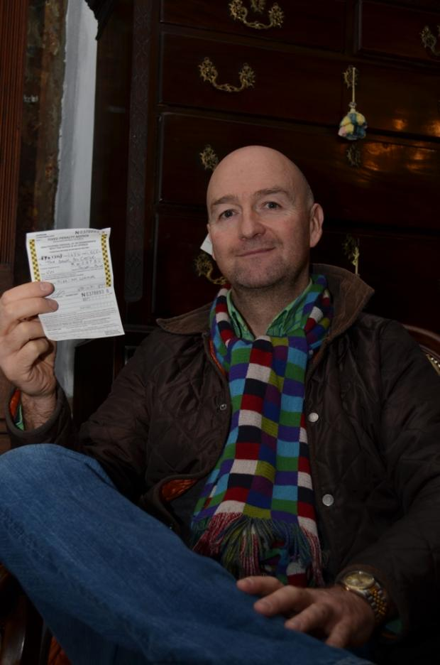 PARKING PLEA: TV antiques expert David Harper shows the parking ticket he received.
