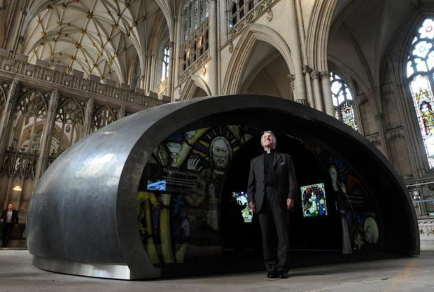 GLASS HIGHLIGHT: The Acting Dean of York, the Reverend Glyn Webster, in front of The Orb