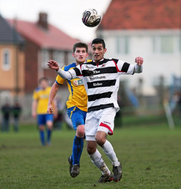 EYE ON THE BALL: Marske's Thomas Marron closes in as Darlington's Amar Purewal receives the ball