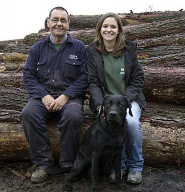 Chris and Angela Storey with Benjy at the sawmill.