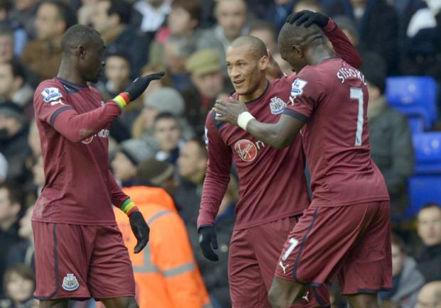The Advertiser Series: FIRST FOR MAGPIES: Newcastle's Yoan Gouffran, centre, celebrates scoring with team-mates Moussa Sissoko, right, and Papiss Cisse at White Hart Lane on Saturday