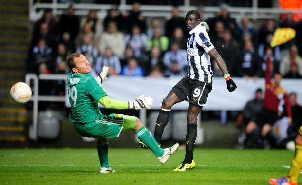 RULED OUT: Papiss Cisse puts the ball beyond goalkeeper Olexandr Goryainov and into the net – only for the offside flag to go up and deny Newcastle a breakthrough on a frustrating night.