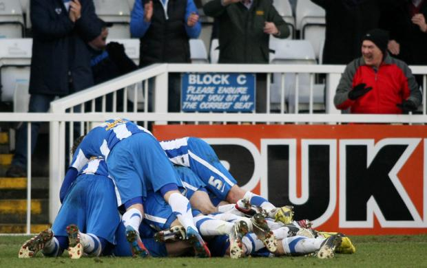 LATE, LATE SHOW: Pools' players pile on top of Luke James after scoring a last-minute winner against Leyton Orient