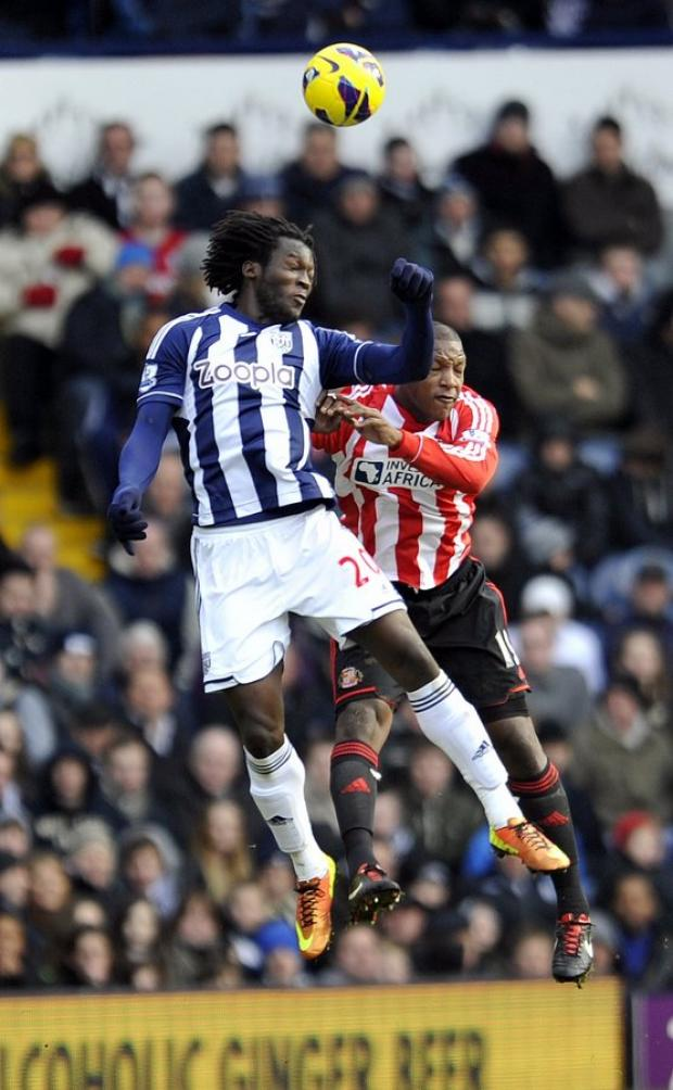 UP AND AT THEM: Lukaku rises higher than Titus Bramble