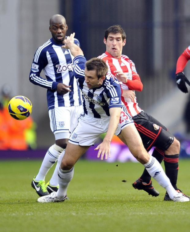 OUT-BATTLED: Danny Graham tries to get among the action during Saturday's 2-1 defeat at The Hawthorns