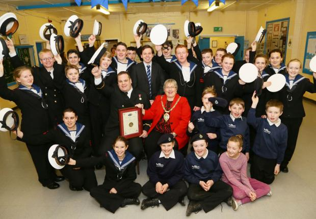 The Advertiser Series: Councillor Linda Marshall and Sub Lieutenant Grainger with some of the sea cadets