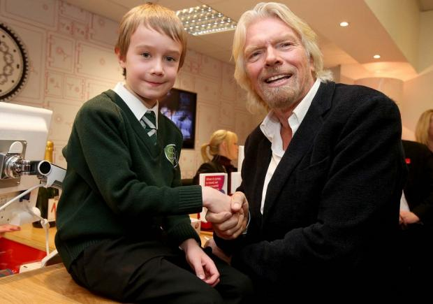 The Advertiser Series: STARTING YOUNG: Sir Richard Branson talks to eight-yearold Dylan Knox, from Blyth, during his brief visit to the Virgin Money branch in Newcastle