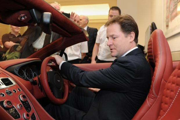 LUXURY CAR: Nick Clegg checks out an Aston Martin Vanquish at the Heritage Motor Centre
