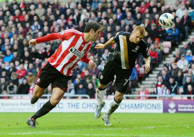 FLASHING A HEADER: Danny Graham, still seeking his first Sunderland goal since moving from Swansea in January, beats Steve Sidwell to the ball