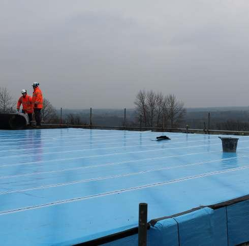Waterproof membrane is added to the roof of  one of the storage tanks.