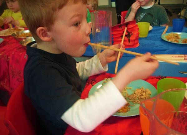 Harrison Storey, four perfects his chopsticks as part of a multi-cultural event at Darlington College's Childcare Centre