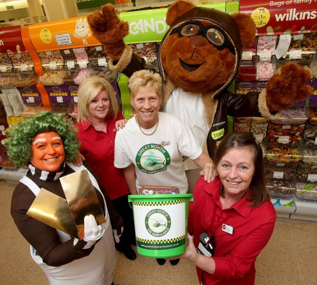 READY FOR TAKE-OFF: Miles the Pilot Bear and Oompa Loompa Sharon Munro, fundraiser for the Great North Air Ambulance Service, join staff members Tracey High, left, Pam Hamilton, centre, and Trudy Boyce visiting the Wilkinson's store in Darlington