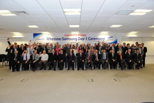 TIME FOR A DEAL: Samsung and Whessoe staff celebrate the deal between the two firms