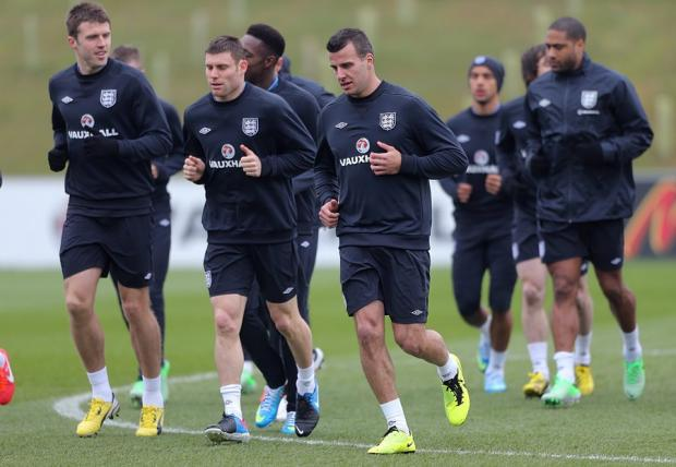 CALL-UP: Newcastle United's Steven Taylor, centre, joins in with an England training session yesterday at St George's Park in Burton