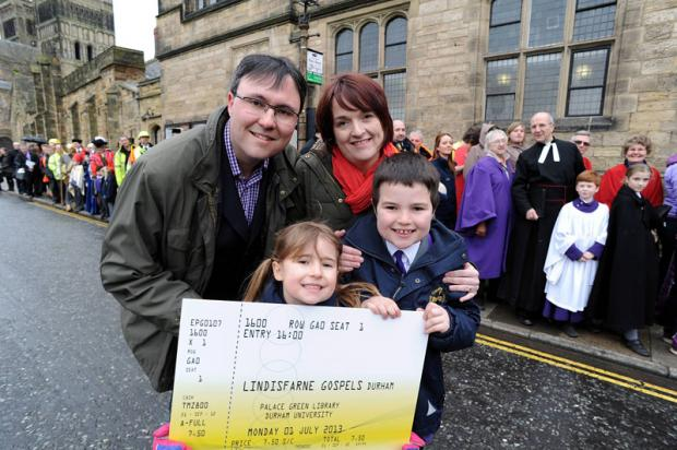 FIRST IN THE QUEUE: Richard and Kirsten Scothon with their children Henry, 8, and Charlotte, 6, who were the first to buy tickets