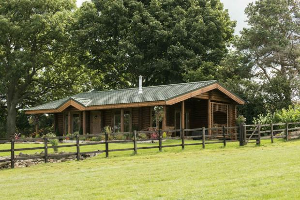 The Advertiser Series: One of the luxury log cabins at Sun Hill Stables