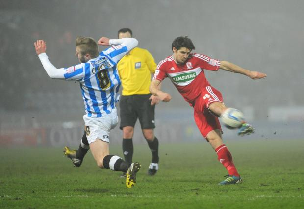 The Advertiser Series: Huddersfield Town's Adam Clayton tries to block a shot from Middlesbrough's George Friend