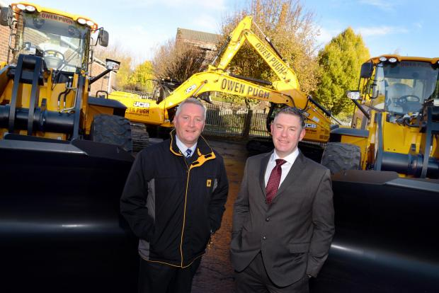 The Advertiser Series: Paul Coates, Scot JCB's regional manager, left, with Paul Cockburn, Owen Pugh and Co general manager